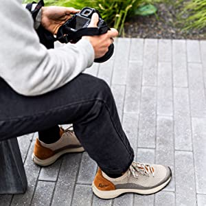 man adjusting his camera