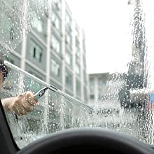 Cleaning the windshield of a car