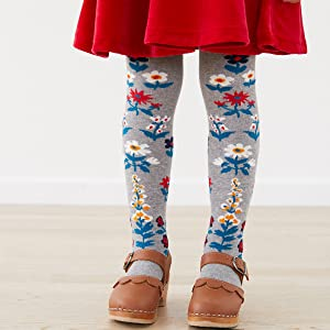 Little girl wearing modern, original hand-drawn art leggings by Hanna Andersson