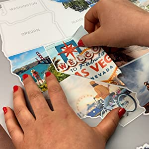 Girl placing a sticker on the photo map.