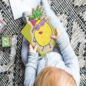 Baby holding a fun card