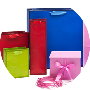 Gift bags and gift boxes in bold, solid colors including baby pink, red, lime green and cobalt blue