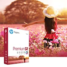 Girl walking through a bright field of pink and white daisies with a ream of Premium32 paper