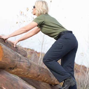 Woman in Summerweight climbing obstacle