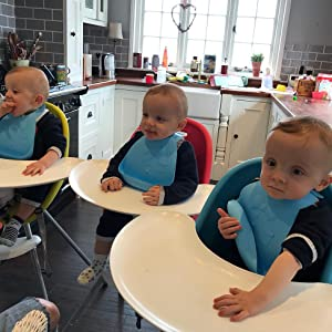 triplets in highchairs