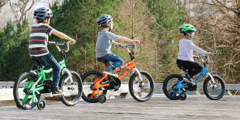 3 kids riding bikes together