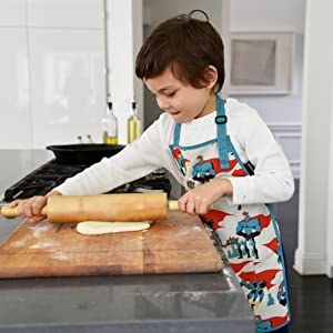 urban infant urban dude little help apron cooking baking boy in kitchen rolling dough