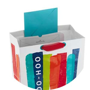 Select Hallmark gift bags feature an innovative card pocket to keep greeting cards front and center