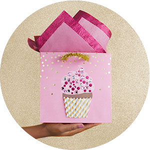 Pretty pink gift bag with sparkly cupcake and tinsel handle for birthdays, baby showers and more