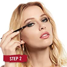 Close-up of woman's face smudging Exaggerate Auto Waterproof Eye Definer to create the look