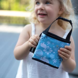 girl holding urban infant toddler travel crayon wallet set