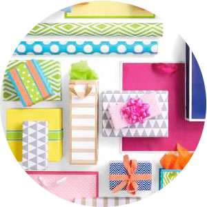 Hallmark birthday gift wrap supplies in bright colors like pink, teal, lime green, aqua and orange