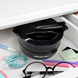 The Collapsible Travel Kettle being stored in a desk drawer.