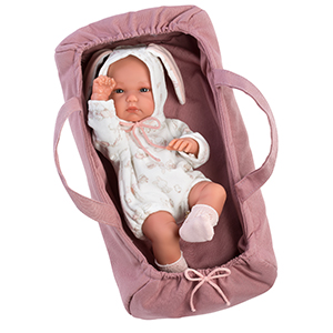 llorens baby doll laying in baby carrier