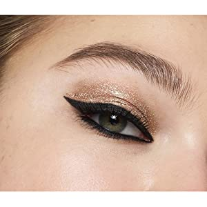 Close up of Model's eye with finished look using Exhibitionist Liquid Glitter Shadow