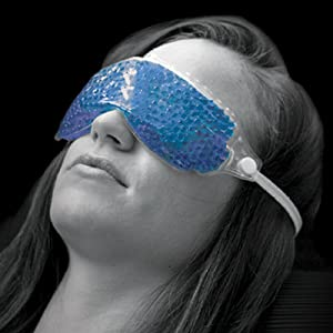 Woman wearing TheraPearl Eye-seential Eye Mask