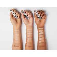 Foundation color swatches on three arms with different skin tones