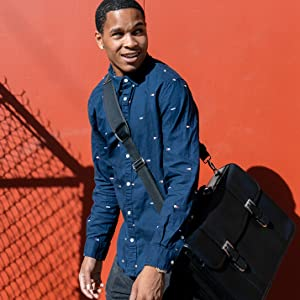 Young kid carrying his Leather Double Compartment Laptop Briefcase with style.
