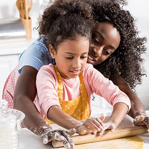Mother and daughter making gluten free food