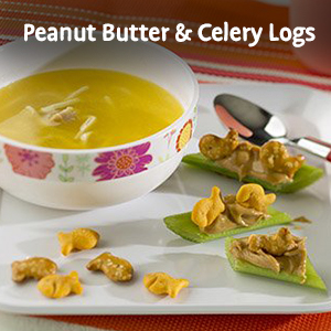 Alt text: Goldfish cheese crackers with peanut butter and celery logs