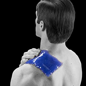Man applying TheraPearl Sports Pack to left shoulder