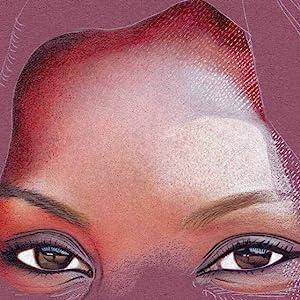 Light shining through the scarf leaves little specks of white light on the face;