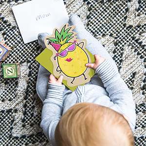baby holding a card