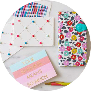Cheerful notecards & journals in bright flowers and pastel stripes make perfect gifts for coworkers