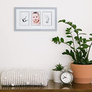 frame shown hung in gender neutral nursery above changing table