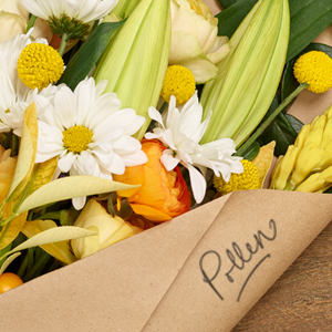 bouquet of flowers with the word pollen written on the paper wrapping