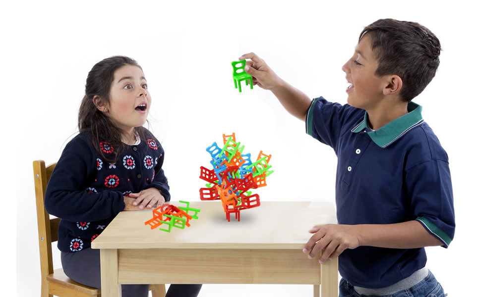 kid play the stacking chairs