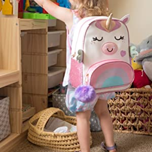 Toddler playing with backpack