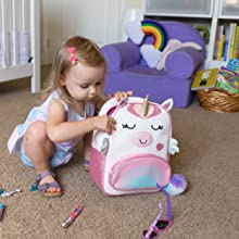Toddler with unicorn backpack