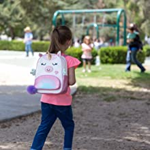 Girl with backpack at school
