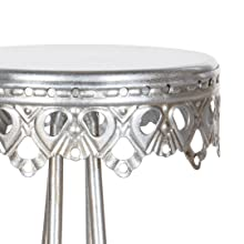 Hand-crafted ornate steel frame painted in an antique silver finish