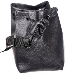 in use image black bag/purse black straps with cylinder cord lock with hook on end attached upright
