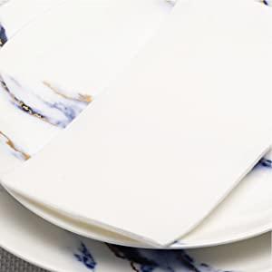 white napkin on set table