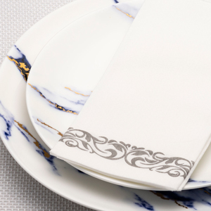 guest towel on plate set table