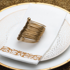 white napkin with gold design set table