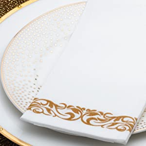 white napkin with gold design stripe