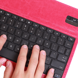 A close up of the pink KX130 BT QWERTY portable compact slim lightweight keyboard iPad functions