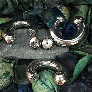 large gauge silver horseshoe on a natural wood background