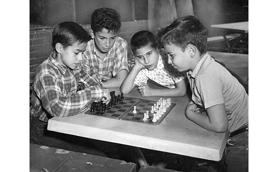 Boys playing chess, fun times, vintage