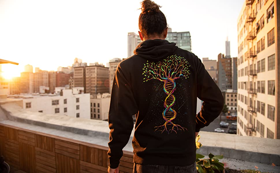 into the am model wearing tree of life graphic hoodie sweatshirt on rooftop in the city
