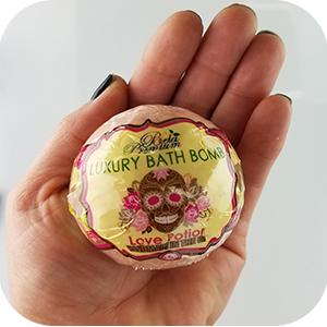 Bela Luxury Bath Bomb in hand.