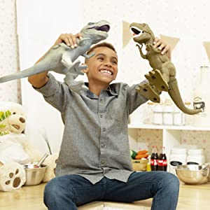 a young child laughs and plays with two boley jurassic t-rex dinosaur toys in a beautiful home