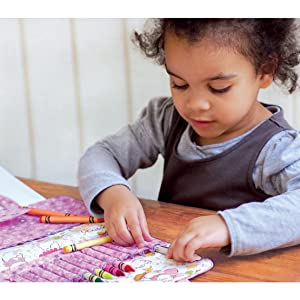 A young child enjoying a portable The Piggy Story art kit for creativity on the go anywhere