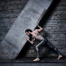 man posing in silver metallic snakeskin mens leggings and meggings