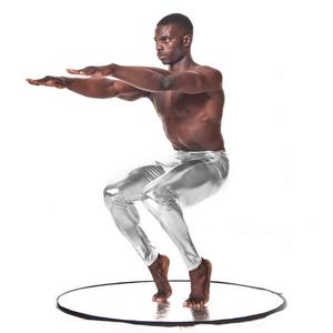 man doing yoga pose in silver shiny metallic mens leggings meggings