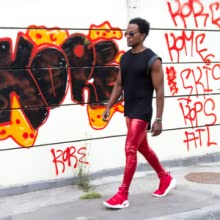 man in red metallic mens leggings walking on street